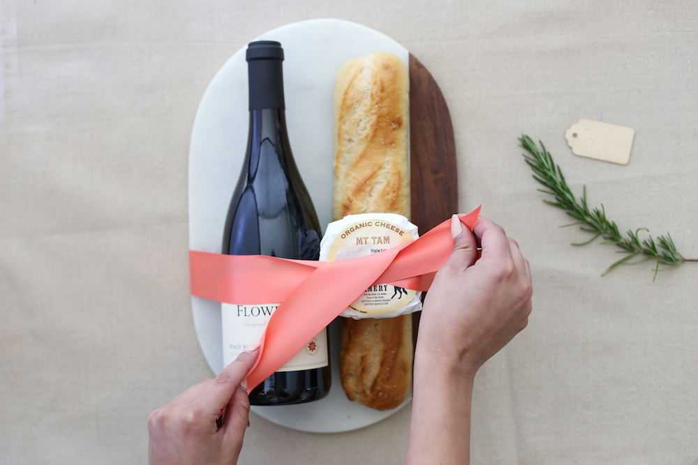 Ribbon being tied on cheeseboard