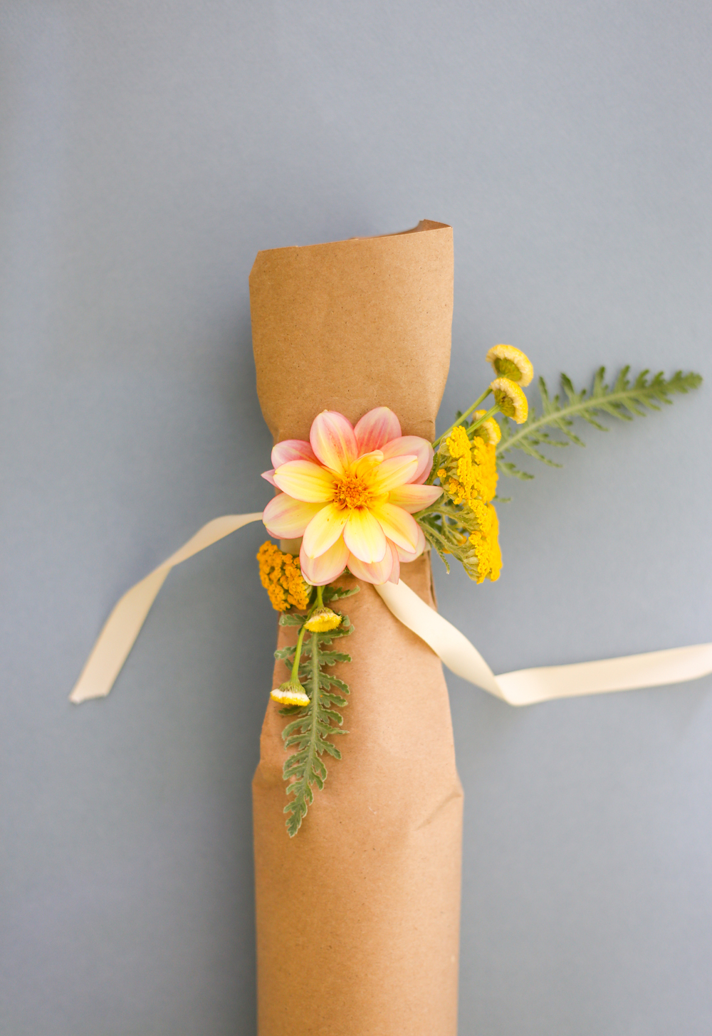 Wine wrapped in craft paper with flowers