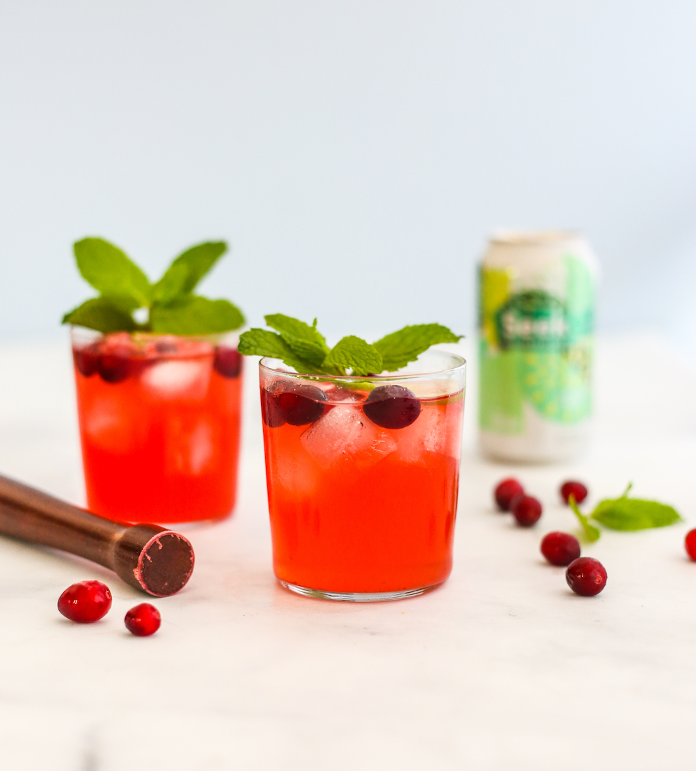Spiked Seltzer Cocktail: Mint Seltzer with Muddled Cranberries and Lime